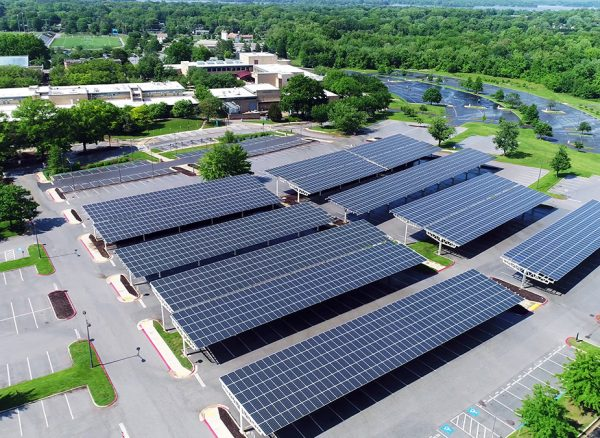 aerial-view-of-solar-panels-installed-in-roof-of-parking-1143727458_1200x675_ecosolar